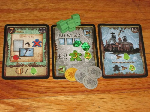 Each player receives a start card, two spyrium, eight money, and three workers at the start of the game. Techniques are placed to the left of the start card, and buildings are played to the right. Players have to pay extra to play building cards to clear a lot for them.