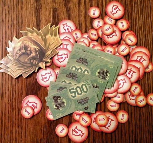 A pile of damage tokens...and the tiny bills.