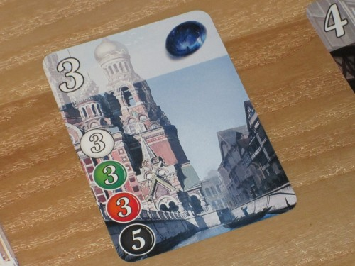 Each card in Splendor has a cost (lower left), a point value (upper left), and a gem (upper right) that provides a discount. Oh yeah, and gorgeous artwork.
