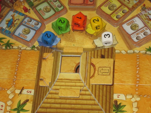 DICE. These drive the action in Camel Up, and the dice pyramid highlights the tension of rolling them.