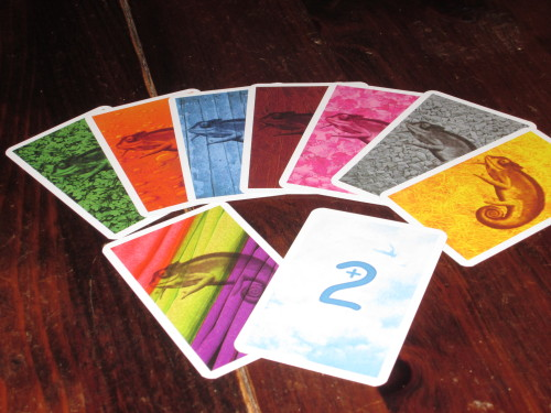 The cards in Coloretto. There are nine each of seven color chameleon cards, four wild cards, and ten +2 cards.
