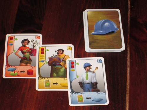 Players begin the game with three expert cards, which begin the tableau bonuses they will inherit during the game.