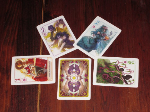 The four suits in Hocus. The card art is gorgeous, as is the design on the back of the cards.