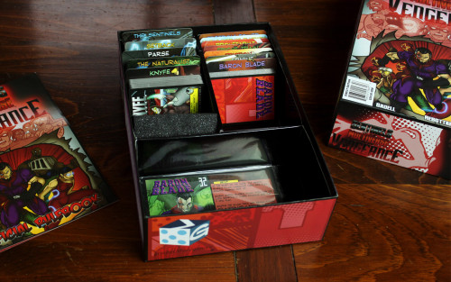 Fortunately, you've got a whole new storage box, including a space for those oversized villain cards! At long last!
