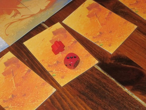 Players move around the hoard using the included die.