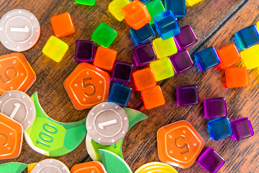 The coins and cubes reflect the colorful art style employed throughout the game.